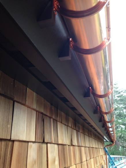 half round gutter mounted on angled fascia